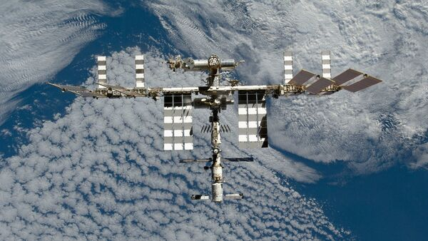 The International Space Station is featured in this image photographed by an STS-133 crew member on space shuttle Discovery after the station and shuttle began their post-undocking relative separation. Undocking of the two spacecraft occurred at 7 a.m. (EST) on March 7, 2011. - Sputnik International