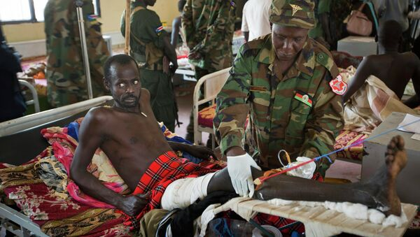 In this December 2013 file photo, a patient is treated by a military doctor in a ward at the Juba Military Hospital in Juba, South Sudan. - Sputnik International