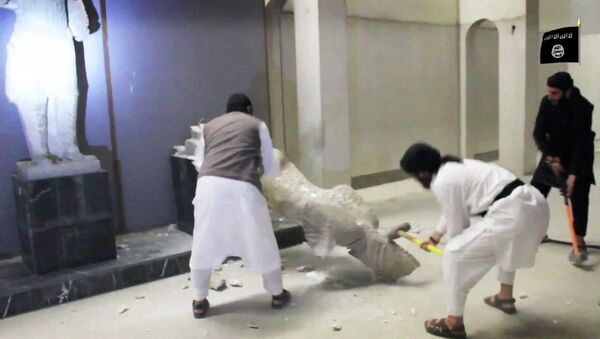 In this image made from video posted on a social media account affiliated with the Islamic State group on Thursday, Feb. 26, 2015, which has been verified and is consistent with other AP reporting, militants take sledgehammers to an ancient artifact in the Ninevah Museum in Mosul, Iraq. - Sputnik International