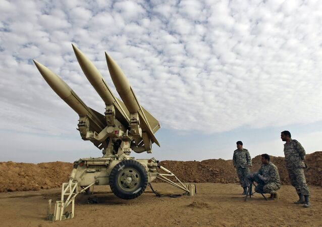 In this photo obtained from the Iranian Mehr News Agency, Iranian army members prepare missiles to be launched, during a maneuver, in an undisclosed location in Iran