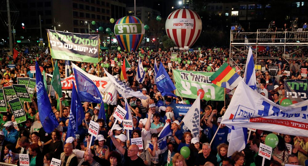 Israelis take part in a rally