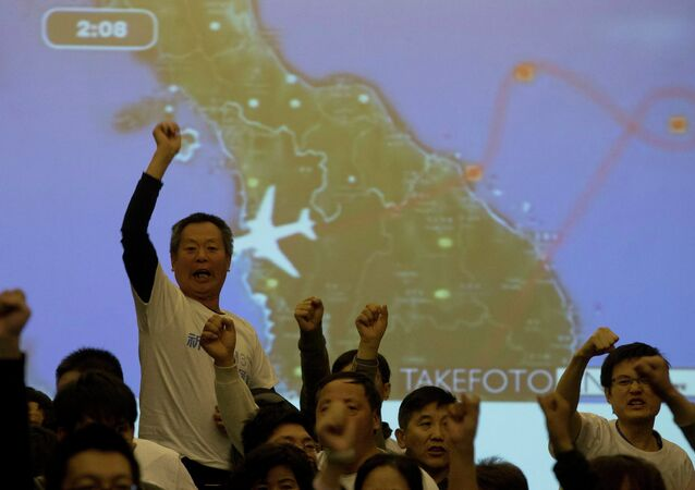 Relatives of Chinese passengers aboard the missing Malaysia Airlines, MH370, turn to journalists to shout their demands for answers after Malaysian government representatives left a briefing in Beijing, China