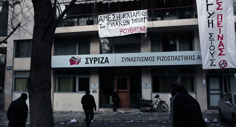 Banners, reading Solidarity With Hunger Strikers'', hang on March 8,2015 at the headquarters of the ruling Syriza party in Athens that were occupied by anarchists in solidarity to hunger strikers and their demands.