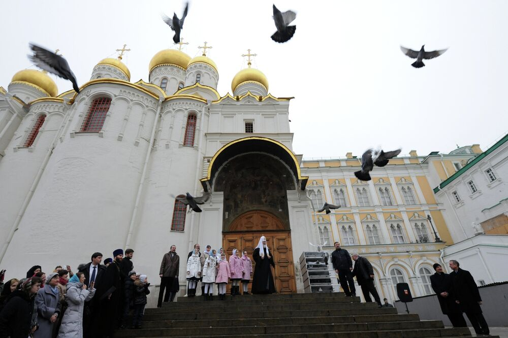 Patriarch Kirill of Moscow and all Russia, center, releasing white doves in the honor of the Annunciation Day after the Divine Liturgy in the Annunciation Cathedral of Moscow Kremlin.