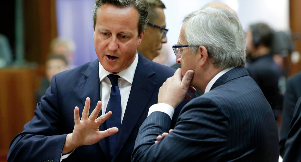British Prime Minister David Cameron, left, speaks with European Commission President Jean-Claude Juncker at an EU summit in Brussels, in 2014.