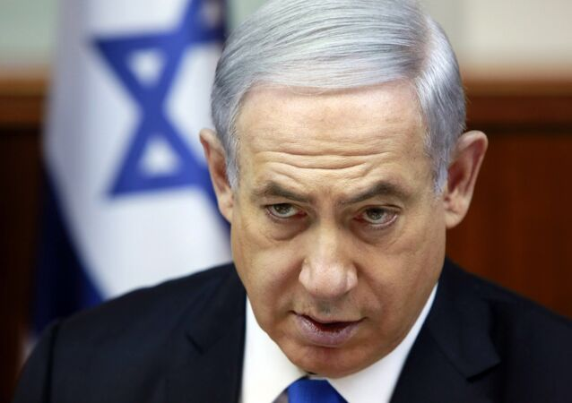 Israeli Prime Minister Benjamin Netanyahu chairs the weekly cabinet meeting at his Jerusalem office, Sunday, March 8, 2015. Tens of thousands of Israelis gathered Saturday night at a Tel Aviv square under the banner Israel wants change and called for Netanyahu to be replaced in March 17 national elections.