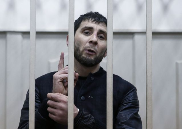 Zaur Dadayev, charged with involvement in the murder of Russian opposition figure Boris Nemtsov, speaks inside a defendants' cage in Moscow