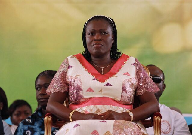FILE In this Jan. 15, 2011 file photo, Simone Gbagbo attends a rally in support of her husband, former President Laurent Gbagbo, as Gbagbo was refusing to relinquish power after being defeated in 2010 elections, in Abidjan, Ivory Coast.
