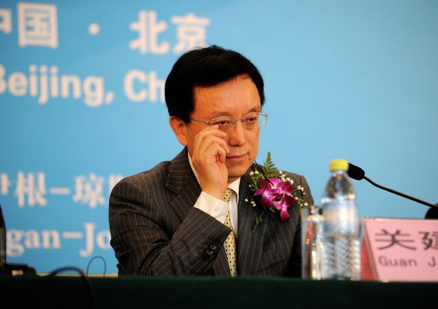 President Guan Jianzhong of Dagong Global Credit Rating reacts as he attends a press conference in Beijing