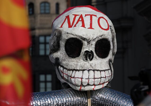 A mask during an anti-NATO protest rally