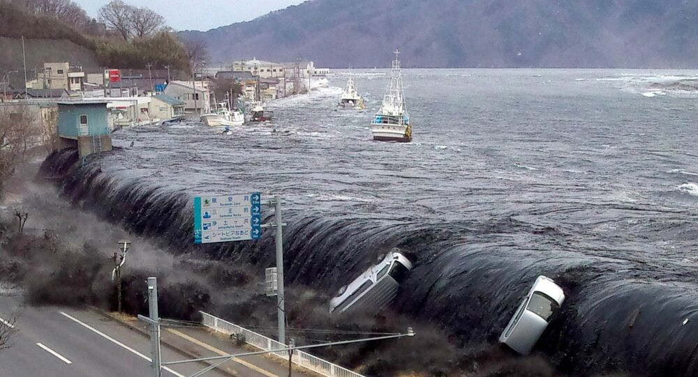 This picture taken by a Miyako City official on March 11, 2011 and released on March 18, 2011 shows a tsunami breeching an embankment and flowing into the city of Miyako in Iwate prefecture shortly after a 9.0 magnitude earthquake hit the region of northern Japan