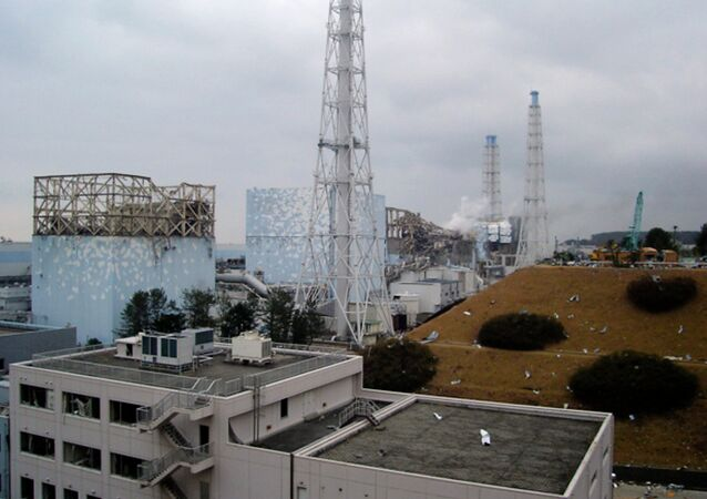 In this image released by Tokyo Electric Power Co., smoke billows from the No. 3 unit among four housings cover four reactors at the Fukushima Dai-ichi nuclear complex in Okumamachi, Fukushima Prefecture, northeastern Japan, on Tuesday, March 15, 2011