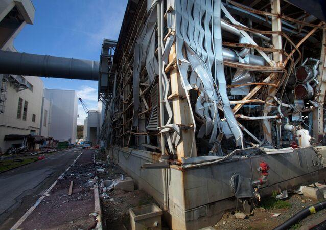 The crippled Fukushima Dai-ichi nuclear power station is seen through a bus window in Okuma on November 12, 2011