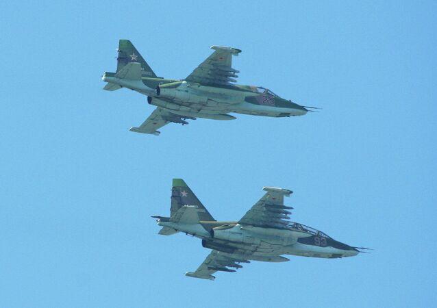 Sukhoi Su-25UB '93 red' & Su-25SM '25 red'