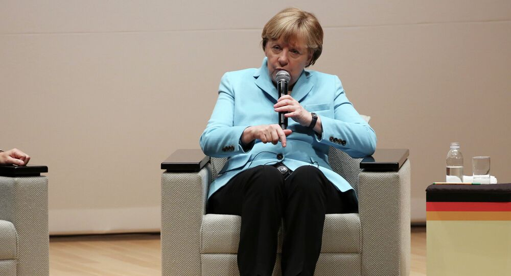 Germany's Chancellor Angela Merkel speaks during a lecture meeting at Asahi Shimbun headquarters in Tokyo, Monday, March 9, 2015