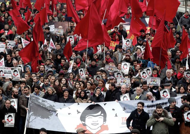 Demonstrators shout anti-goverment slogans as they attend commemoration for Berkin Elvan in Istanbul March 7, 2015