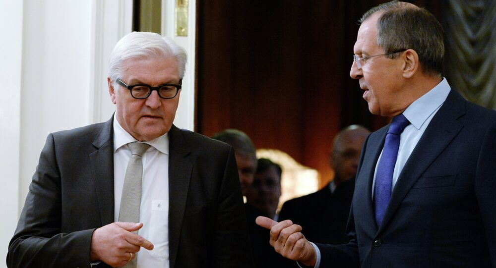 Russian Foreign Minister Sergei Lavrov (R) speaks with his German counterpart Frank-Walter Steinmeier