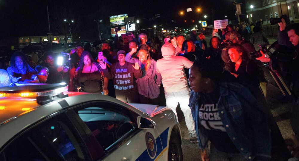 Protestors block a police vehicle from entering the City of Ferguson Police Department and Municipal Court parking lot in Ferguson Missouri, March 11, 2015