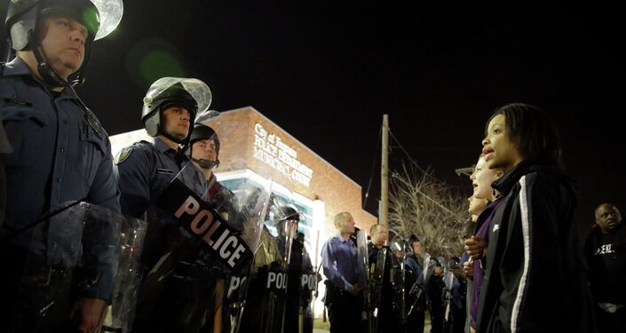 Police and protesters square off outside the Ferguson Police Department, Wednesday, March 11, 2015, in Ferguson, Mo