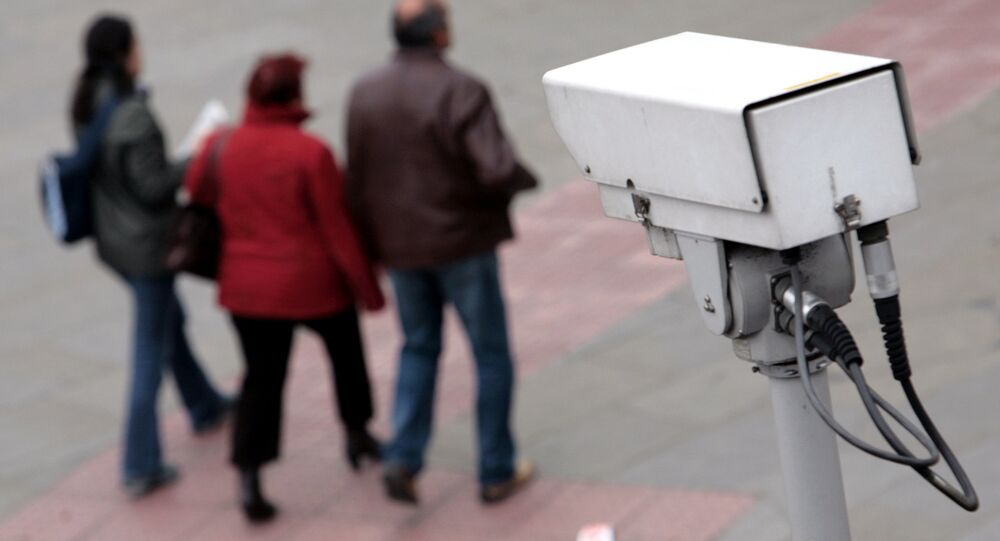 A police CCTV camera observes people walking in the Embankment area of central London. File photo