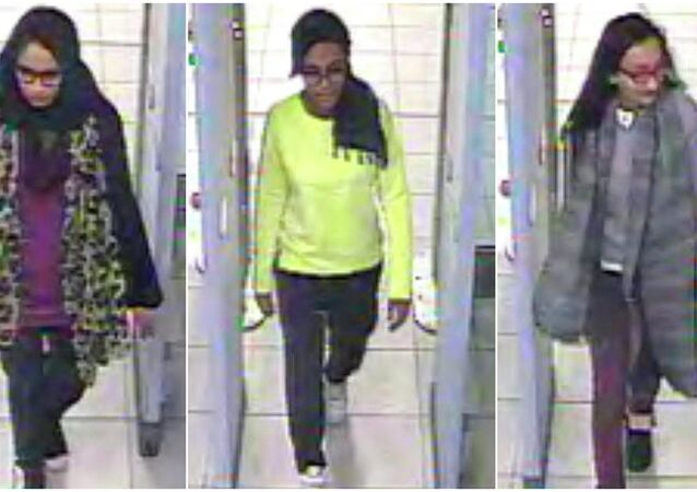 British teenage girls Shamima Begun, Amira Abase and Kadiza Sultana (L-R) walk through security at Gatwick airport before they boarded a flight to Turkey on February 17, 2015