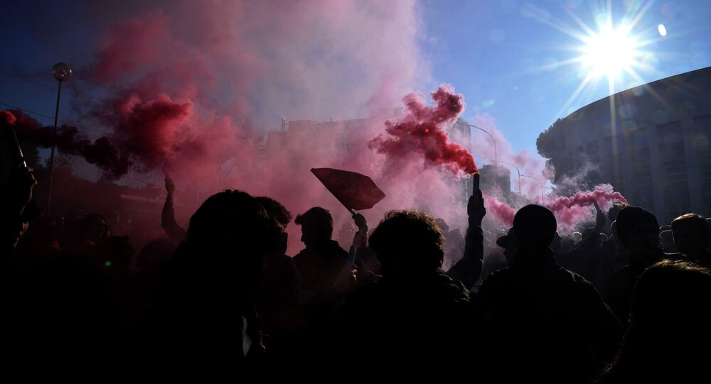 Students hold flares