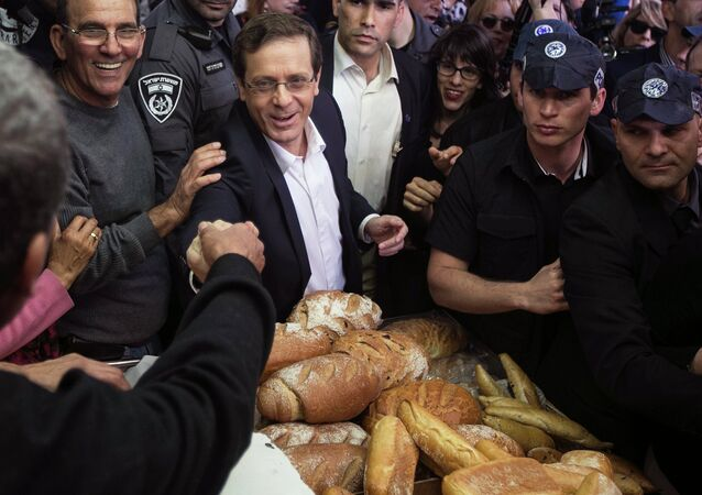 Isaac Herzog, co-leader of the centre-left Zionist Union, gestures during a campaign stop at a fruit and vegetable market in Tel Aviv March 12, 2015