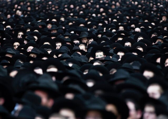 Ultra-Orthodox Jews take part in a rally supporting the United Torah Judaism party in Bnei Brak near Tel Aviv