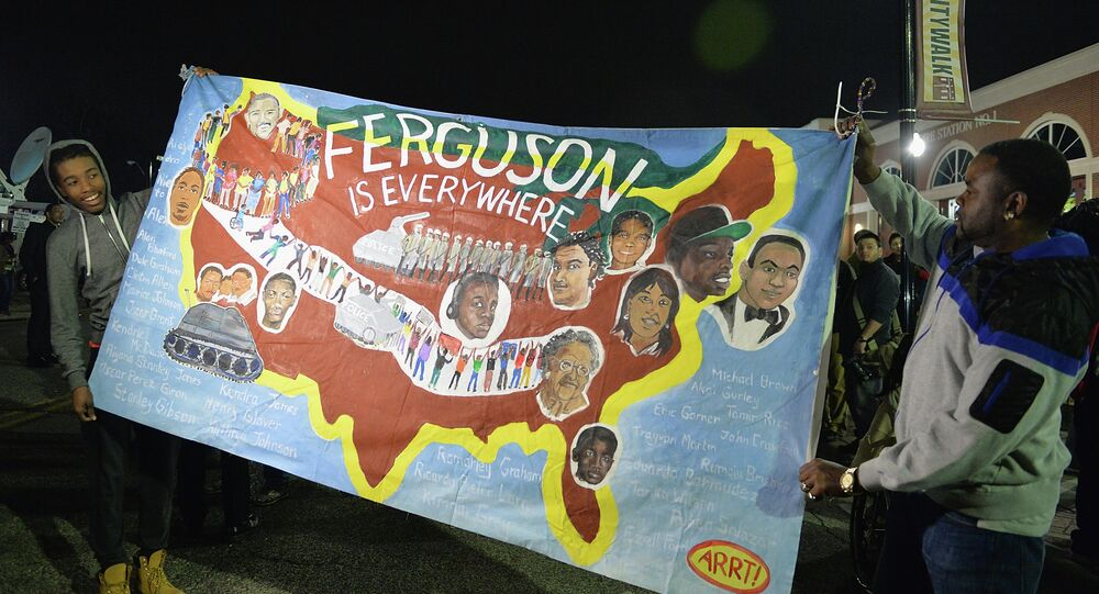 Protestors demonstrate outside the Ferguson Police Department in Ferguson, Missouri on March 12, 2015