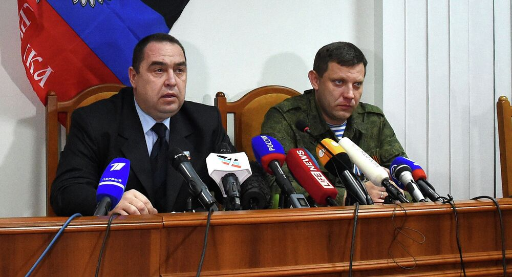 Prime Minister of the self proclamed Peoples Republic of Donetsk Alexander Zakharchenko (R) and Prime Minister of the self proclaimed Peoples Republic of Lugansk Igor Plotnitsky speak during a press conference in the eastern Ukrainian city of Donetsk on Febuary 2, 2015