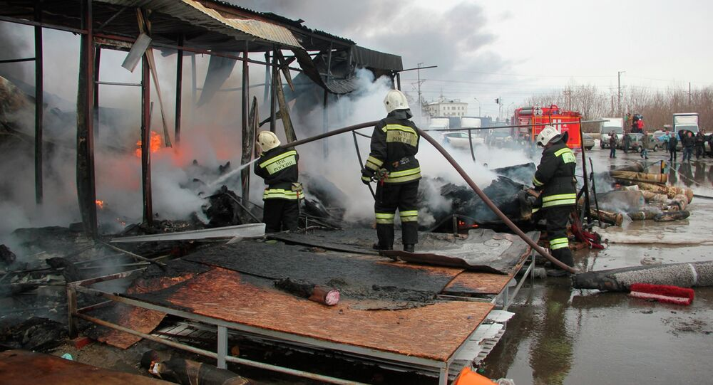 Firefighters extinguish a fire at a shopping mall in Kazan, 720 kilometers (450 miles) east of Moscow, Russia, Wednesday, March 11, 2015