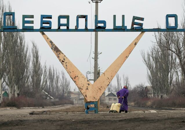 Photo: Partially damaged sign marking Debaltseve city limits, February, 2015.