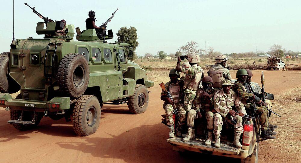 Nigerian army soldiers along a road in Chibok, northeastern Nigeria, on March 5, 2015