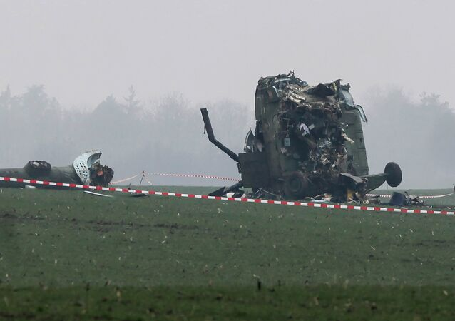 The wreckage of a military helicopter is pictured at the crash site near Belgrade airport, March 14, 2015