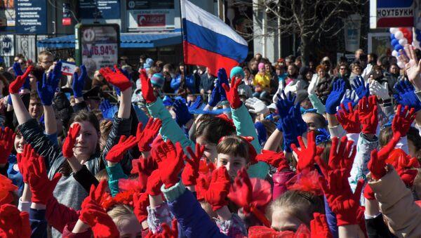Participants of the Crimean Spring anniversary celebrations march in downtown Simferopol - Sputnik International