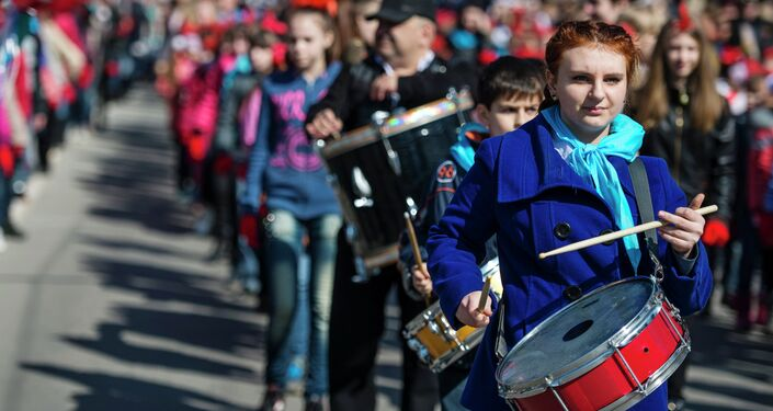 Participants of the Crimean Spring anniversary celebrations march through downtown Simferopol