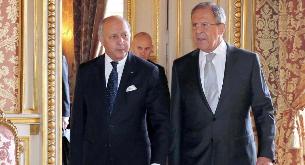 French Foreign Affairs Minister Laurent Fabius, left, walks with his Russian counterpart Sergei Lavrov at the French Foreign Affairs Ministry before a meeting in Paris.