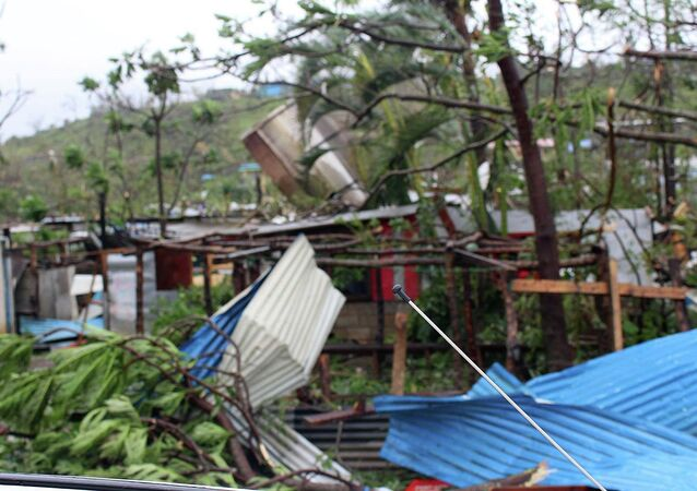 Debris is scattered over a building in Port Vila, Vanuatu, Saturday, March 14, 2015, in the aftermath of Cyclone Pam
