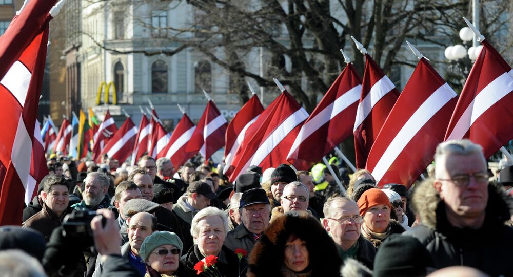 People carry Latvian flags at the march in Riga, Latvia