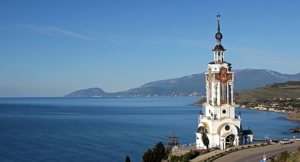 View of the St. Nicholas the Wonder Worker church/light house in the village of Malorechenskoye in the Crimea's Sudak District.