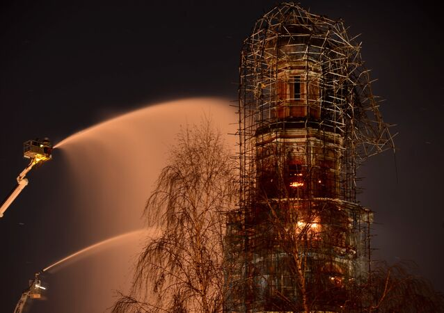 The bell tower of Moscow's 16th century Novodevichy ConventThe Novodevichy Convent  on fire