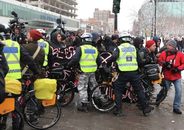 Police on bicycles begin to kettle protesters during an anti-police brutality demonstration in Montreal March 15, 2015.