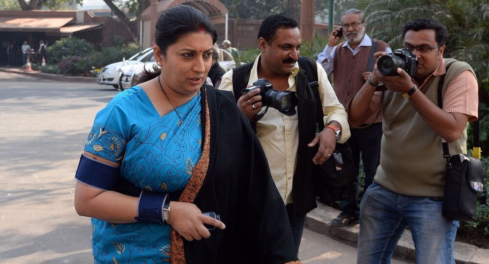 Indian Human Resource Development Minster Smriti Irani arrives for the start of the winter session of Parliament in New Delhi.
