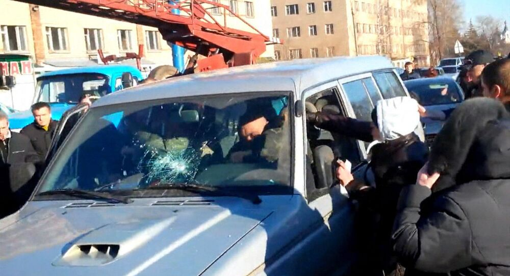 Residents of Kostiantynivka came to protest against Ukrainian army personnel stationed in the town, after two soldiers, driving an armored vehicle, hit a woman with two children on Monday