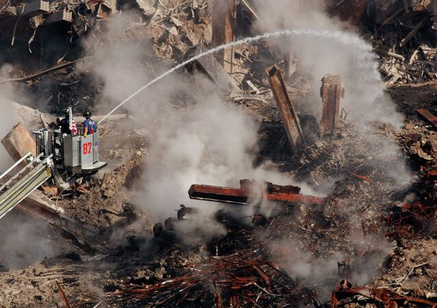 Firefighters hose down hot spots on the rubble of the World Trade Center in New York, Friday, Oct. 12, 2001 as work continues to remove debris and victims of the Sept. 11 attack. Officials say 4,776 people are still missing in the wreckage of the twin towers; 442 people have been confirmed dead and 384 of those have been identified.