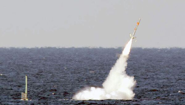 A Tomahawk cruise missile is seen emerging from the ocean after being launched from the USS Florida. - Sputnik International