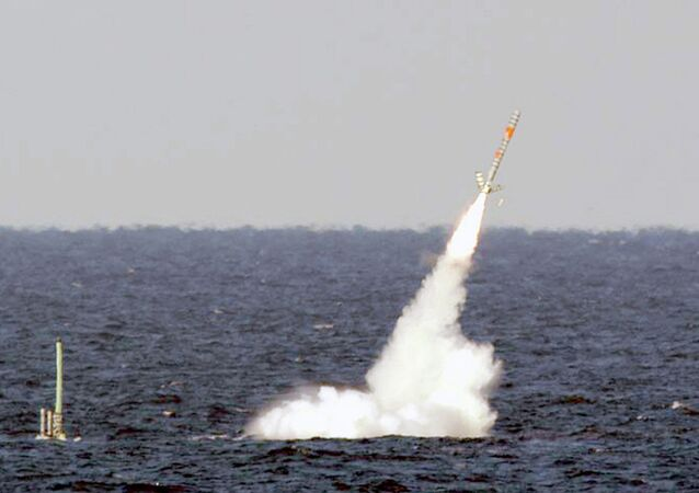 A Tomahawk cruise missile is seen emerging from the ocean after being launched from the USS Florida.