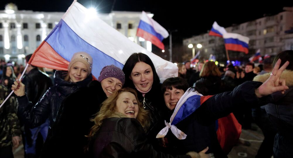 Women pose for a picture during a concert marking the one-year anniversary of Crimea voting to leave Ukraine and join the Russian state, in central Simferopol on March 16, 2015
