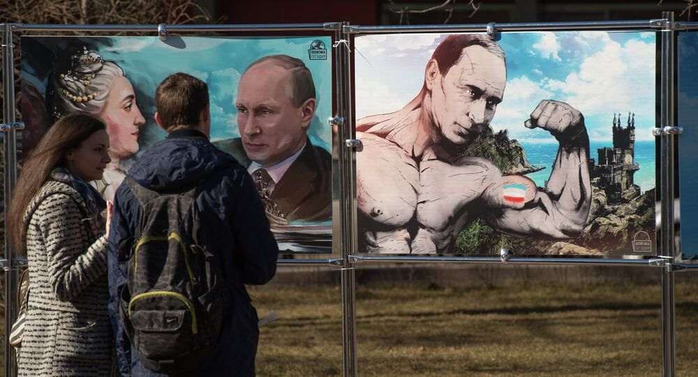 A couple stands by pictures depicting Russia's President Vladimir Putin at an open-air political cartoons exhibition dedicated to the one-year anniversary of Crimea voting to leave Ukraine and join the Russian state in central Moscow on March 16, 2015.
