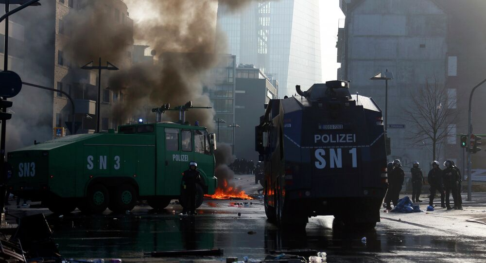 Police vehicles are seen on streets during a protest of 'Blockupy' anti-capitalist movement members near the European Central Bank (ECB) building before the official opening of its new headquarters in Frankfurt March 18, 2015.